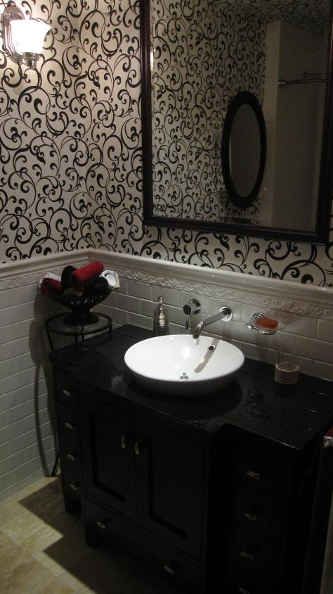 Custom vanity designed specially for this traditional Guest Bathroom